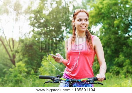 Sports Woman With A Bike And A Phone