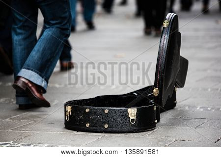 an image with a suitcase open in the middle of the road.