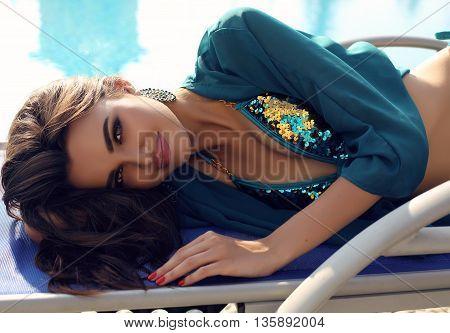 Gorgeous Sensual Woman With Dark Hair In Elegant Swimsuit