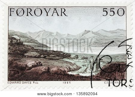LUGA RUSSIA - JUNE 26 2016: A stamp printed by FAROE ISLANDS shows Faroese landscape. Engraving after drawing by painting of famous English watercolour artist Edward Dayes circa 1985.