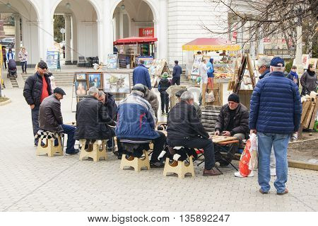 Kislovodsk, Russia - 28 February, People playing backgammon on the street, 28 February, 2016. Resort zone Mineral Waters, Krasnodar region.