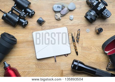 Equipment for hiking adventure on a wooden floor background