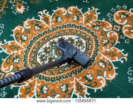 carpet vacuuming with vacuum cleaner at home.