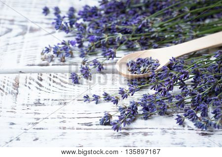 Bunch of lavender flowers on an old wood table.