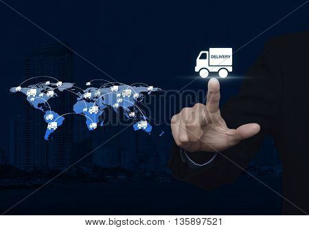 Businessman pressing delivery truck icon with connection line over map and city background Logistic concept Elements of this image furnished by NASA