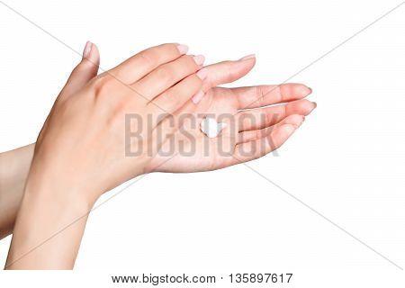 Female beautiful delicate manicured hands with moisturizing cream isolated on white background
