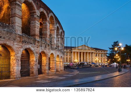 Verona Italy - May 07 2016: View of the Verona Arena against the backdrop of the Barbieri Palace evening time