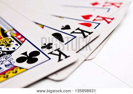 four kings cards on white backgriond, closeup