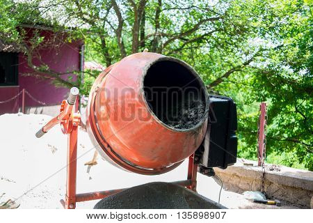 cement mixer mixing and pouring in the cart