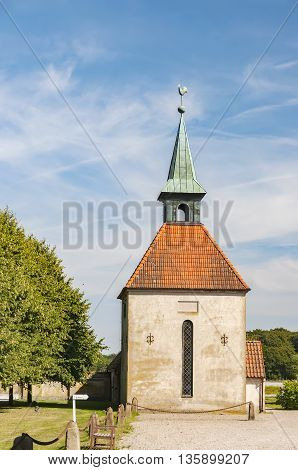 An image of an ancient stone church on the grounds of Loberod castle in Sweden.