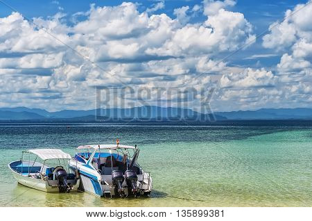 Two motor boats used to carry tourists about in the idyllic setting of Thailand.