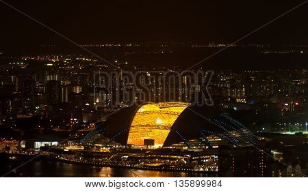 Aerial view of Singapore National Stadium at night.
