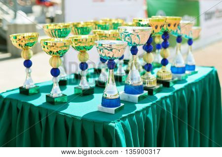 Victorious cups in sports meets. Cups of winners. Trophy cups. Trophy cups on the table.