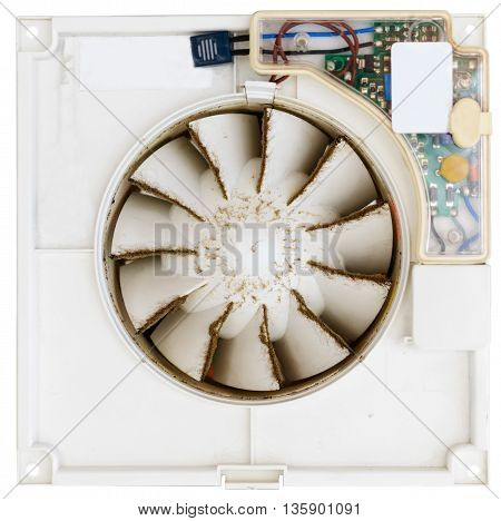 Built-in exhaust fan. Dirty dusty fan. Isolated on white background. Shallow depth of field.