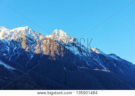 peaks of the Caucasus Mountains in sunny day