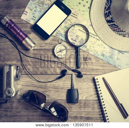 Set Of Travel Accessory On Wooden Background