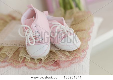 Waiting for the baby. Pregnancy. Shoes for the little baby.