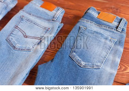 Jeans on a white wooden background. blue jeans. clothes on a brown background.