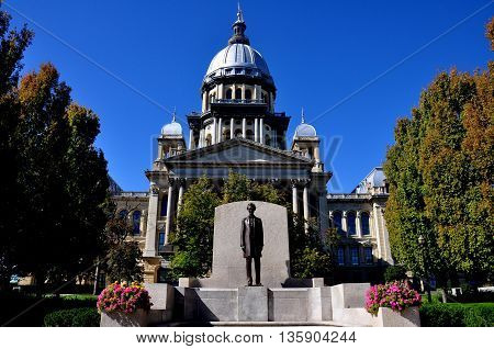 Springfield Illinois: A statue of Abraham Lincoln stands in front of the 1868 Illinois State House with its immense dome and classical facade