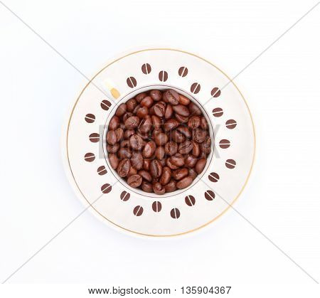 Coffee cup with coffee grains. Top view on a white background