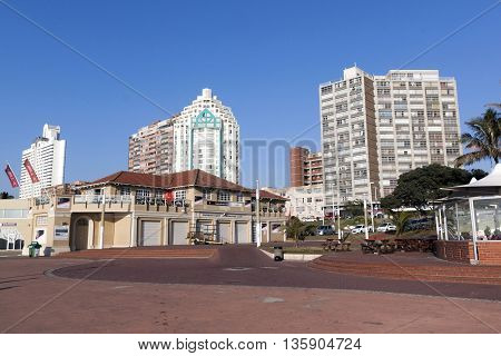 Empty Beach Front Paved Promenade And City Skyline