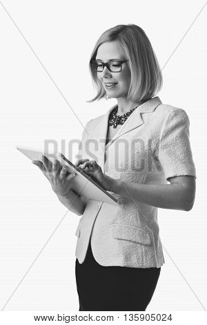 POrtrait of elderly business woman in glasses with tablet in hands. Happy smiling expression.Isolated over white background. Copy space.