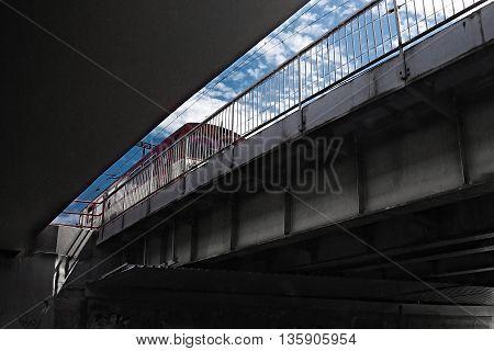 train ride from Jirkov to Luzna u Rakovnika under the bridge in the street 'Blatenska' in Chomutov in Bohemia