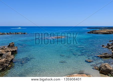 Photo of sea in protaras cyprus island with rocks and immaculate water.