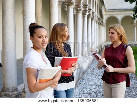 Three young females friends all together at college