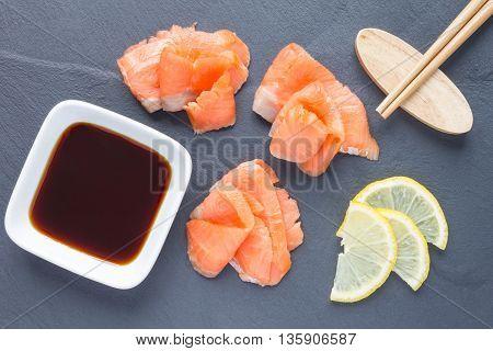 Smoked salmon filet with soy sauce on gray stone horizontal