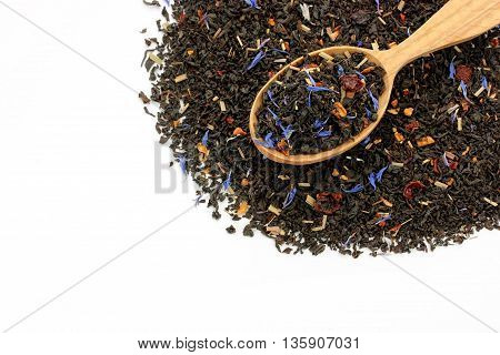 Fruit flowers petals black tea in spoon isolated on white background blank space for text