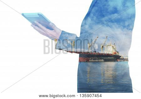 Double Exposure Of Businessman Hand Hold Tablet, Cargo Port Ship At Sea Port Concept