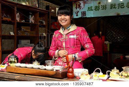 Chengdu China - December 4 2013: Smiling young woman working in a traditional tea shop on Jin Li Street