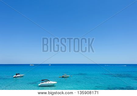 Photo of sea in protaras cyprus island with boats and immaculate water.
