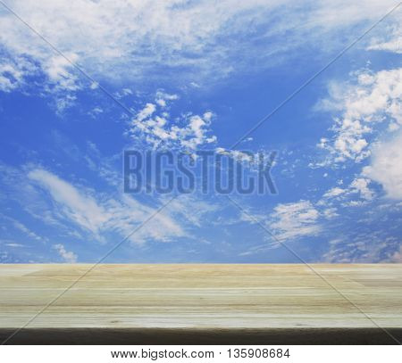 Empty wooden table over blue sky for your product display montage