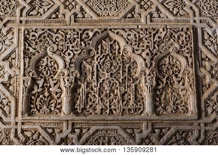 Detail of a 800 years old wall in arabic style. Alhambra, Granada. South of Spain