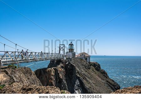San Francisco Bay,California,USA - June 8, 2015 : View of Point Bonita Lighthouse and its bridge