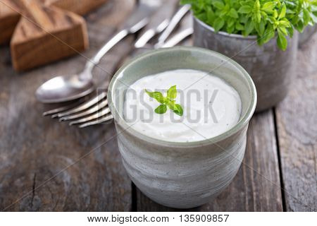 Horseradish and cream sauce in small cup