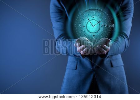 Businessman holding virtual clock in time is money concept