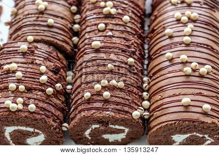 Close up beautiful chocolate Yam Roll in white plate