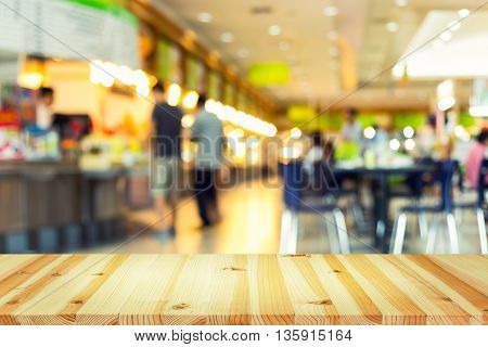 Defocused or blurred photo of food court.