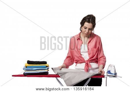 Young woman doing ironing isolated on white