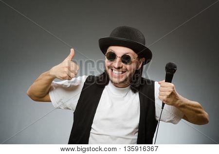 Funny man in karaoke club