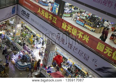 Shenzhen, China - Jun 15, 2016: Inside view of a technology market center for shopping with many Made in China tech products and toys, digital accessories.