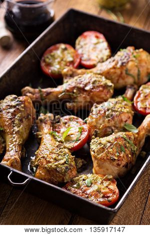 Grilled chicken and tomatoes served with basil pesto