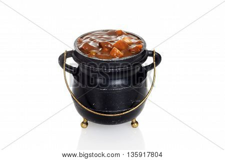isolated beef stew in old small cauldron