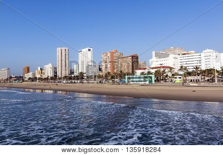 Landscape Of Calm Ocean Empty Beach  Against City Skyline