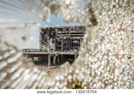 Wide Angle view of donetsk airport ruins through broken glass after massive artillery shelling
