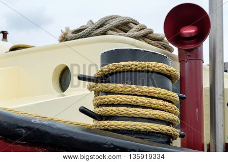 Rope on a bollard on a ship anchored in the port of Amstedam, The Netherlands