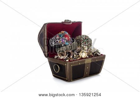 Chest with lots of jewellery isolated on white